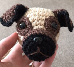 cuddly crochet dog being made - head first