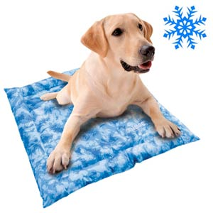 dog keeping cool on a cooling mat